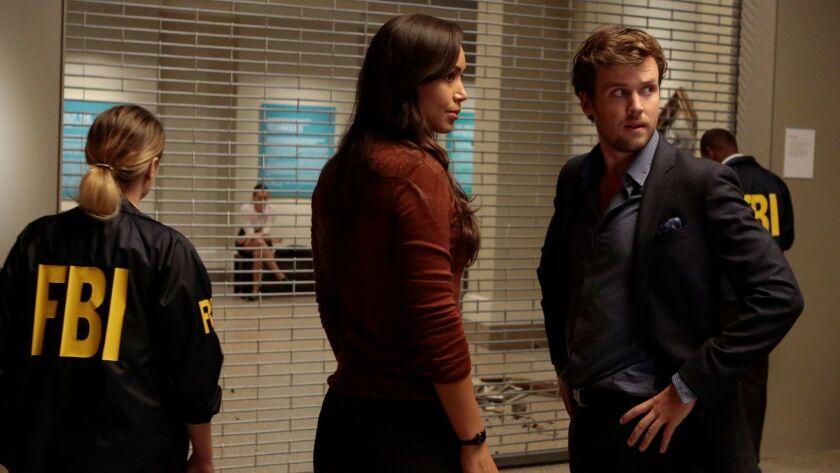 """Ilfenesh Hadera, left, and Jack Cutmore-Scott in ABC's """"Deception."""""""
