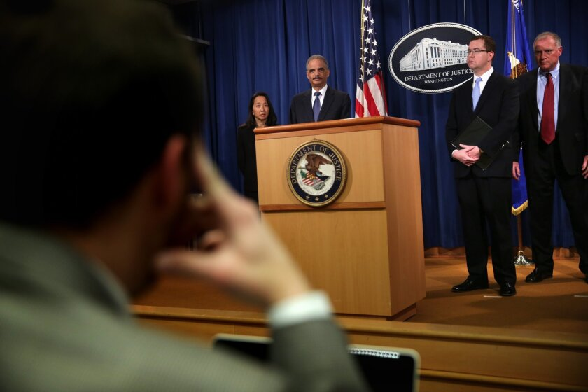 Atty. Gen. Eric Holder is pictured at a news conference to make a major financial fraud announcement Feb. 3, 2015, at the Justice Department in Washington.
