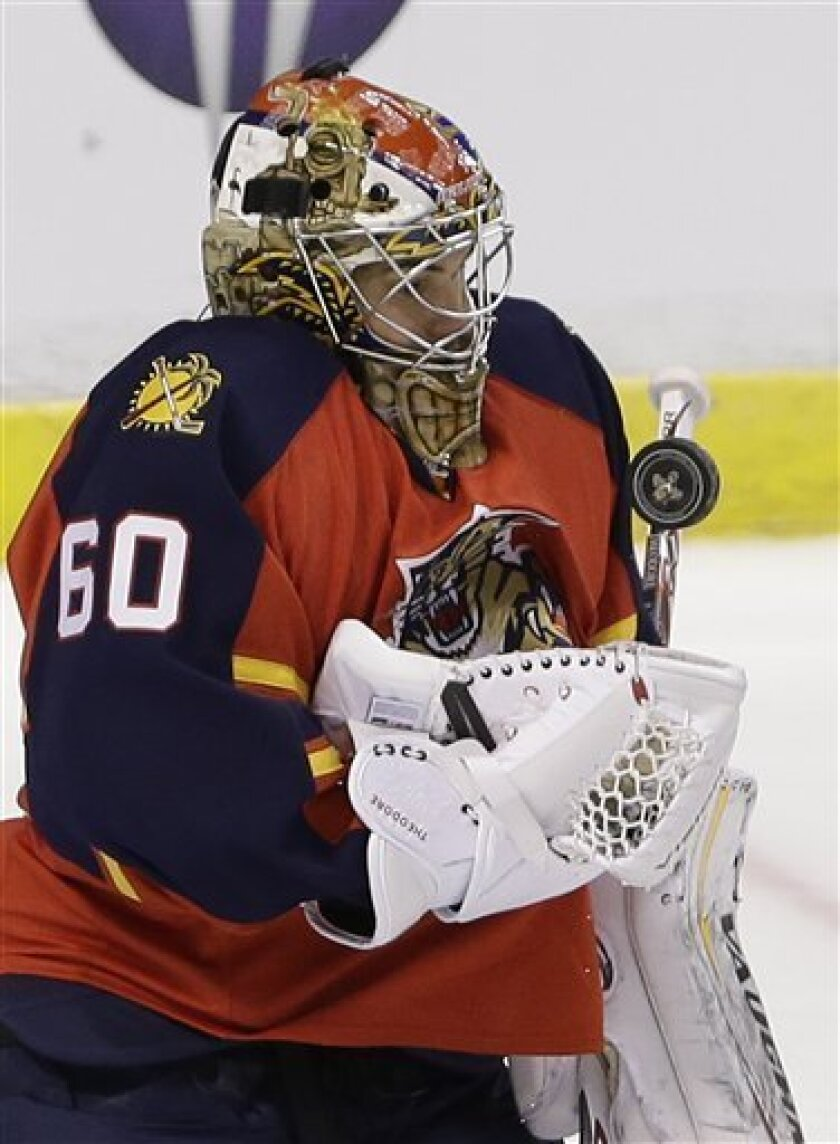 Florida Panthers goalie Jose Theodore makes a save during the second period of an NHL hockey game against the Montreal Canadiens, Thursday, Feb. 14, 2013, in Sunrise, Fla. (AP Photo/Wilfredo Lee)