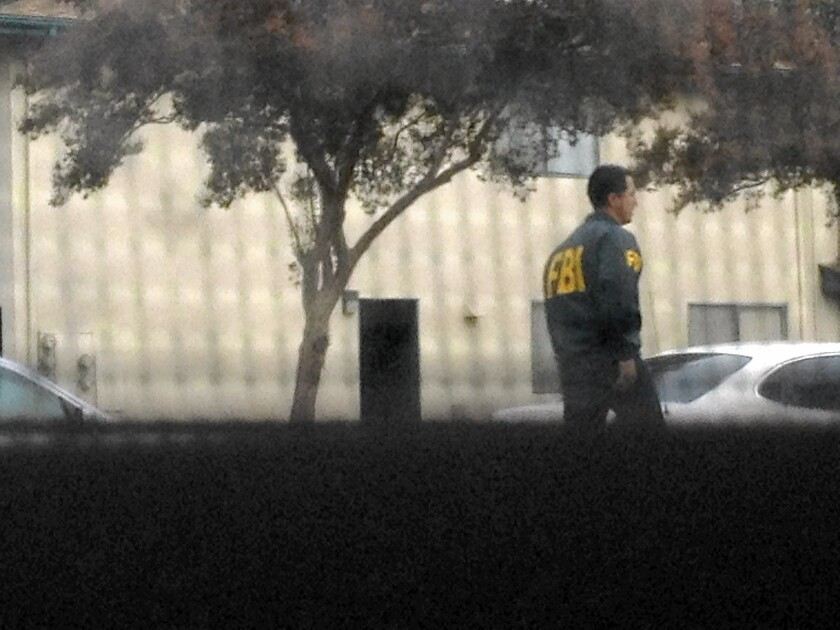 FBI investigators outside the Upland home of Miguel Alejandro Santana, one of four men with ties to Southern California who were charged in a 2012 terror plot.