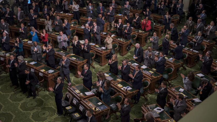 Legislators take a stand in honor of first responders at the state's many emergencies last year as Gov. Jerry Brown delivers his final State of the State address Thursday.