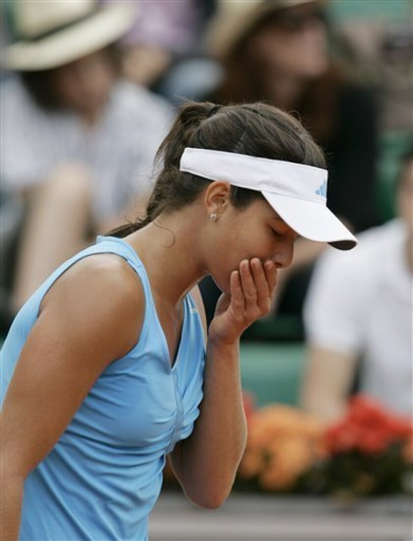 Serbia's Ana Ivanovic reacts after missing a point to Belarus' Victoria Azarenka  during their fourth round match of the French Open tennis tournament at the Roland Garros stadium in Paris, Sunday May 31, 2009. (AP Photo/Lionel Cironneau)
