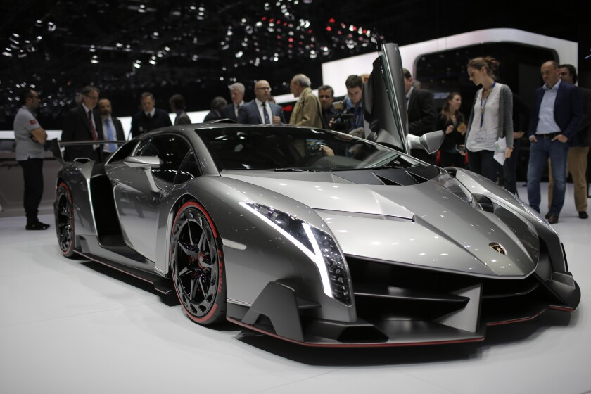 FILE - This Tuesday, March 5, 2013 file photo shows the new Lamborghini Veneno during the first media day of the 83rd Geneva International Motor Show, Switzerland. On Sunday, Sept. 28, 2019, an auction house in Switzerland is set to sell 25 luxury cars including Ferraris, Rolls-Royces and a Lamborghini Veneno that Geneva authorities seized from the son of Equatorial Guinea's president in a money-laundering probe. (AP Photo/Laurent Cipriani, file)