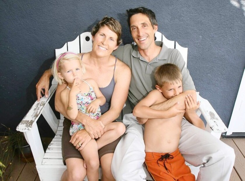 Lysanne Sebastian sits with daughter Sage, 3, husband Rick, and son Bradley, 5, at thier Costa Mesa home. Lysanne is one of several ladies who appear in 16-month calendar featuring survivors from Orange County.