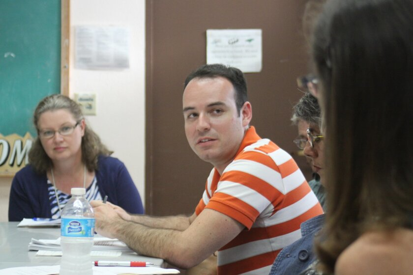 Alex Llerandi, a California Coastal Commission coastal program analyst, answers questions.