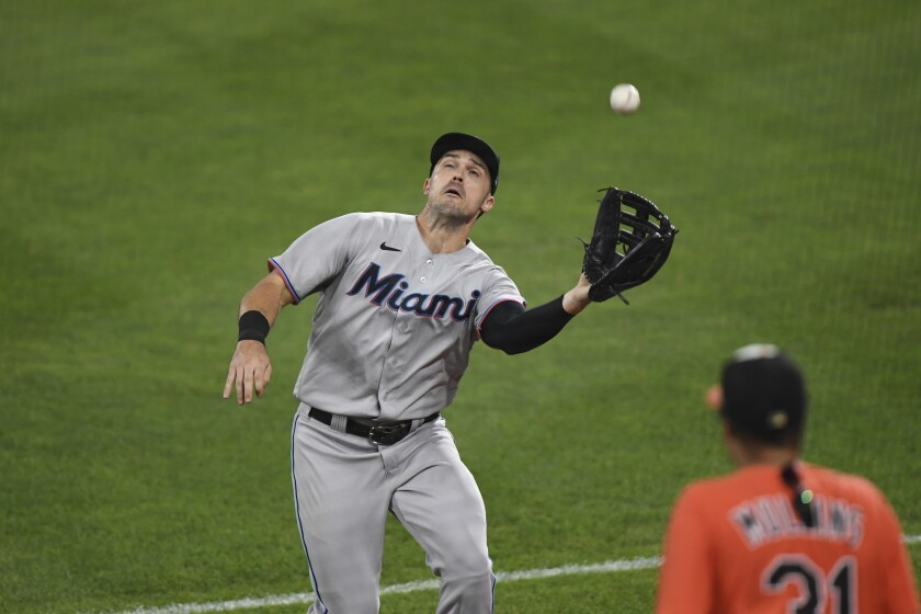 Miami Marlins right fielder Adam Duvall catches a foul ball hit by Baltimore Orioles' Ryan Mountcastle during the eighth inning of a baseball game Tuesday, July 27, 2021, in Baltimore. (AP Photo/Terrance Williams)