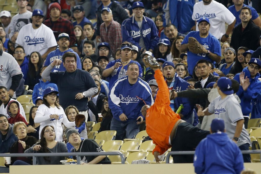 The Los Angeles Dodgers and Los Angeles Angels fans got a jolt during an exhibition baseball game in L.A. Veteran announcer Vin Scully kept his cool.