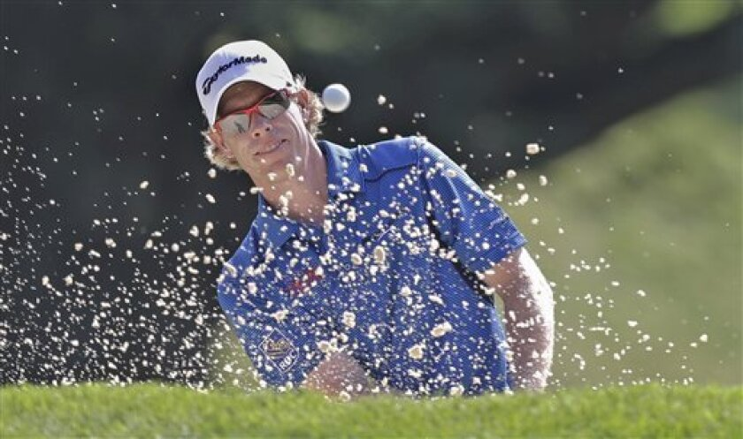 David Hearn, of Canada, hits out of a bunker on the ninth hole during the first round of the PGA Championship golf tournament at Oak Hill Country Club, Thursday, Aug. 8, 2013, in Pittsford, N.Y. (AP Photo/Charlie Neibergall)