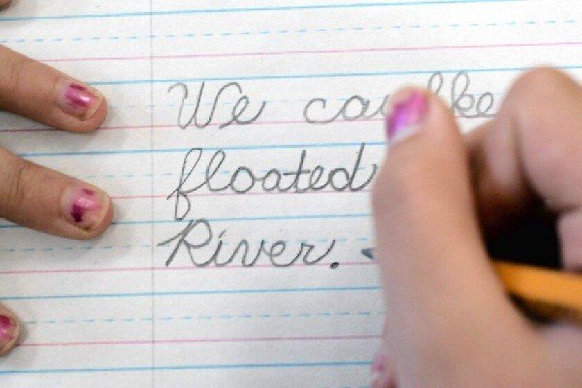 A student practices penmanship