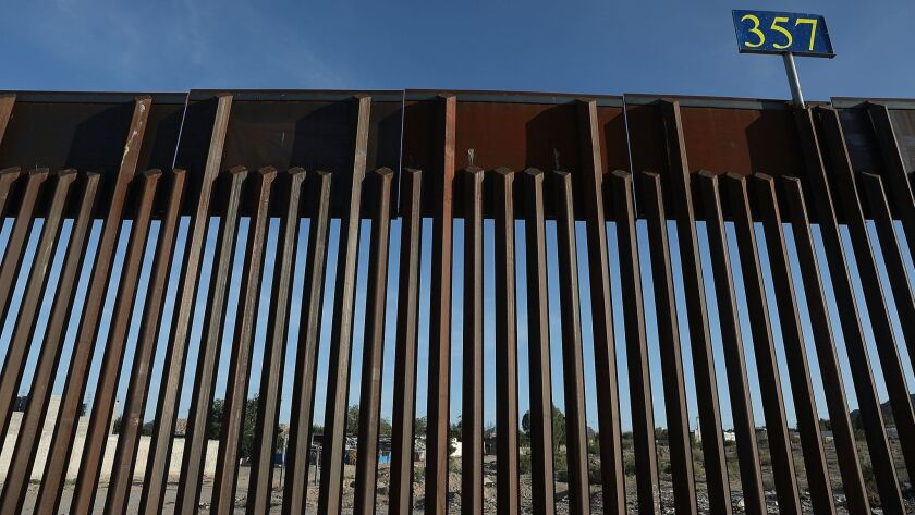 The U.S.-Mexico border fence in Sunland Park, N.M., in July.