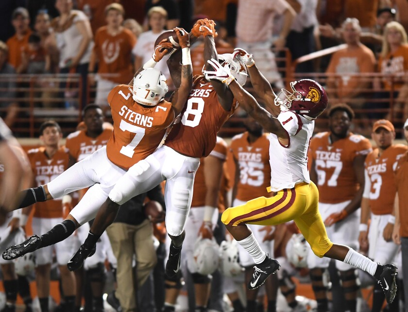 USC receiver Velus Jones can't make the catch as Texas defenders Caden Sterns (7) and Davante Davis defend in the second quarter at Royal-Texas Memorial Stadium on Saturday.