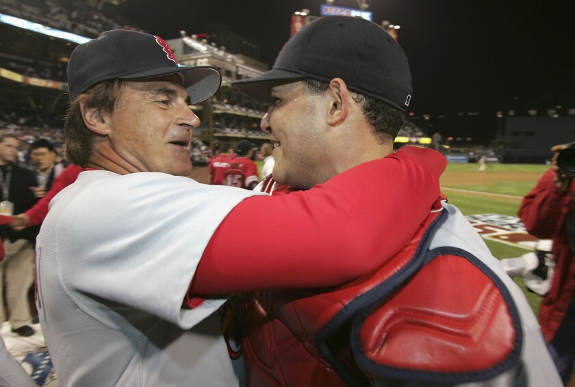 Manager Tony La Russa hugs catcher Yadier Molina after Cardinals defeated the Padres to clinch the 2005 NLDS at Petco Park.