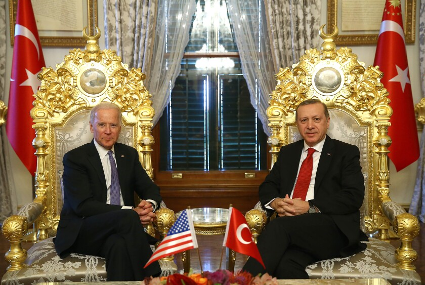 FILE- In this Saturday, Jan. 23, 2016 file photo, then U.S. Vice President Joe Biden, left, poses for photographers with Turkey's President Recep Tayyip Erdogan, right, prior to their meeting at Yildiz Mabeyn Palace in Istanbul. Erdogan has toned down his anti-Western and anti-US rhetoric in an apparent effort to reset the rocky relationship with his NATO allies. So far, however, he's been met by silence from U.S. President Joe Biden. Nearly two months into his presidency, Biden still hasn't called Erdogan, which some in Turkey see as a worrying sign. (Kayhan Ozer/Presidential Press Service, Pool via AP, File)