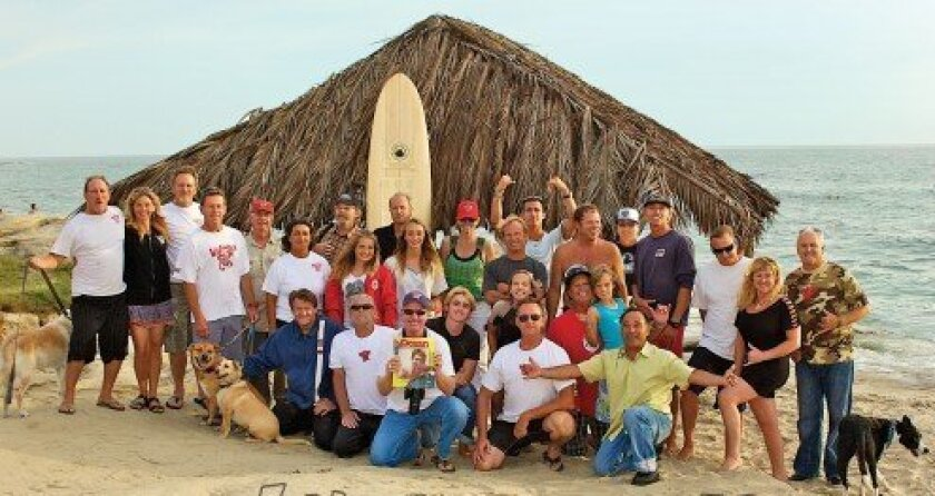WindanSea Surf Club members gather in front of La Jolla's historic WindanSea beach shack, which the club and other community members restored in May 2012. Surf Dawn Patrol