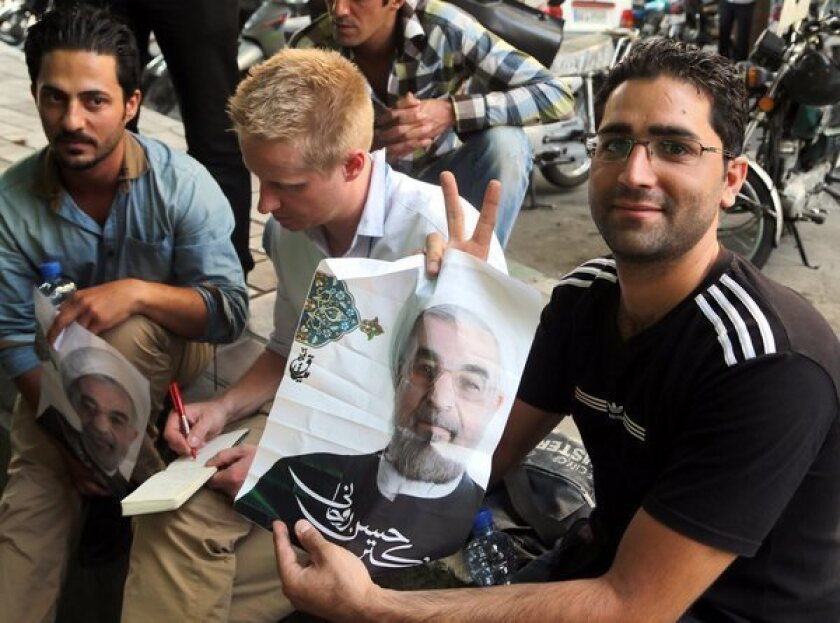 Supporters of Iranian presidential candidate Hassan Rowhani near his campaign office in Tehran, Iran.