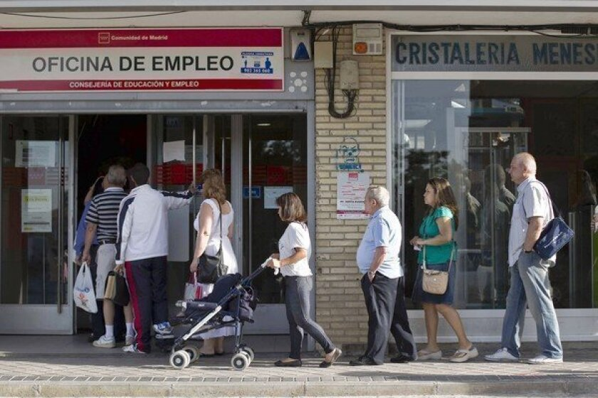 People in Madrid enter an unemployment registry office. Europe's economic crisis has become a popular motif on the U.S. presidential campaign trail.