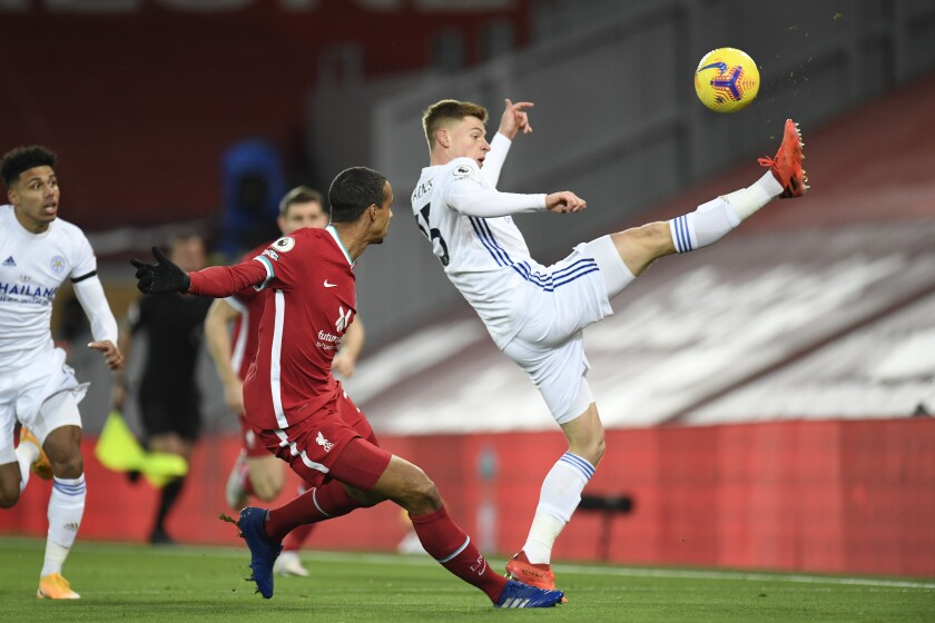 Leicester's Harvey Barnes, right, and Liverpool's Joel Matip fight for the ball during the English Premier League soccer match between Liverpool and Leicester City at Anfield stadium in Liverpool, England, Sunday, Nov. 22, 2020. (Peter Powell/Pool via AP)
