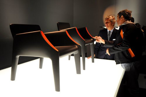 At the 2010 Salone Internazionale del Mobile, the Milan furniture fair where the world's greats in home décor are gathered to premiere their 2010 collections, Philippe Starck strode up to the pedestal where the designer's new outdoor chairs were perched like art. He ran his fingers over the soft curves of the silky polyethylene, and as cameras flashed and onlookers nudged closer to hear his verdict on the display, Starck didn't say much of anything to Claudio Luti, owner of manufacturer Kartell, also pictured here. Instead, Starck peered into an armrest, where gloomy black suddenly gave way to sunny orange, and he smiled. A light at the end of the tunnel. Optimism reins at this year's show. Hop along for a tour of the bright (and not so bright) ideas to premiere this year.