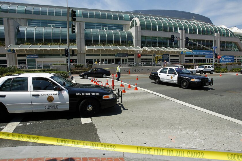 A 53-year-old Comic-Con visitor was struck by a car and killed  in front of the convention center on Harbor Drive at 5th Ave. on Tuesday, July 10, 2012. According to police, the woman was in crosswalk, but went against the light when she was struck. Here, police secure the scene.
