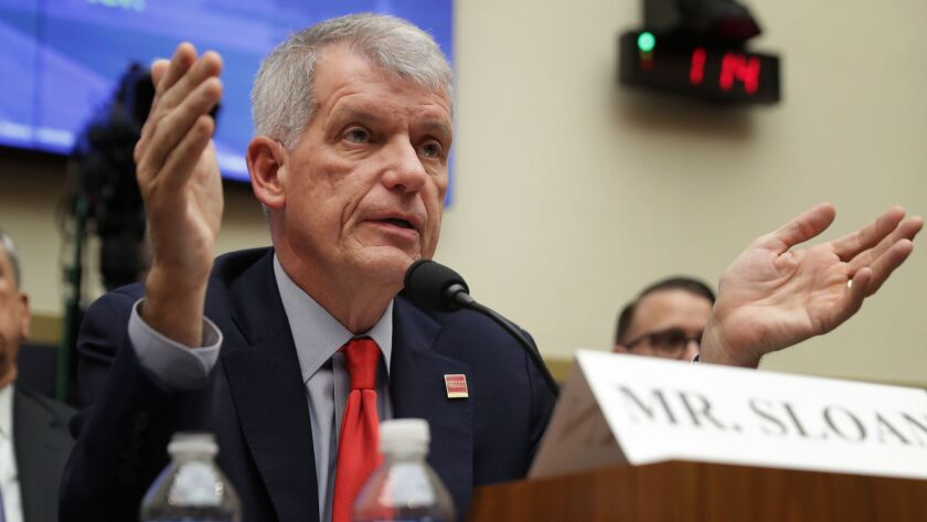 Wells Fargo CEO Tim Sloan testifies before lawmakers on the House Financial Services Committee on March 12.