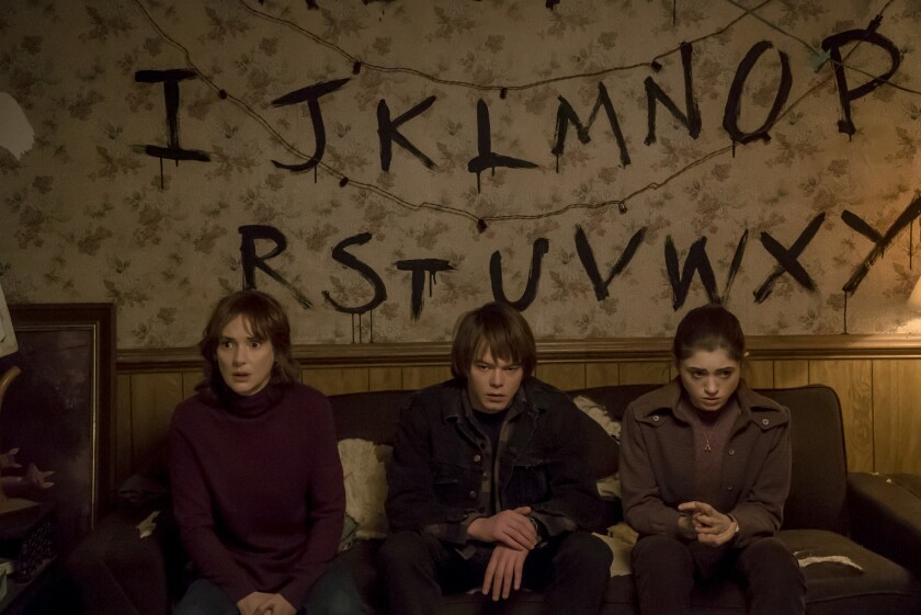 """Winona Ryder, Charlie Heaton and Natalia Dyer in """"Stranger Things."""""""