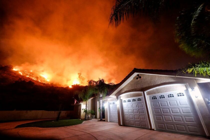 The Holy fire burned near homes in the Cleveland National Forest in Lake Elsinore, Calif. on Aug. 9. 2018. The Orange County Sheriff's Department is now investigating a San Clemente woman who allegedly fabricated a firefighter husband to collect more than $11,000 in donations.