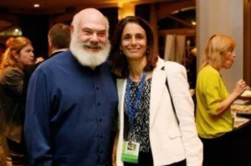 Dr. Andrew Weil and Dr. Mimi Guarneri pose for a photo at the Natural Supplements Conference presented by the Scripps Center for Integrative Medicine. Courtesy