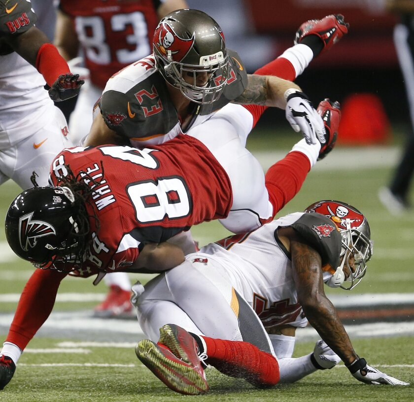 Tampa Bay Buccaneers strong safety Chris Conte (23) and Tampa Bay Buccaneers free safety Bradley McDougald (30) hit Atlanta Falcons wide receiver Roddy White (84) during the second of an NFL football game, Sunday, Nov. 1, 2015, in Atlanta. (AP Photo/John Bazemore)