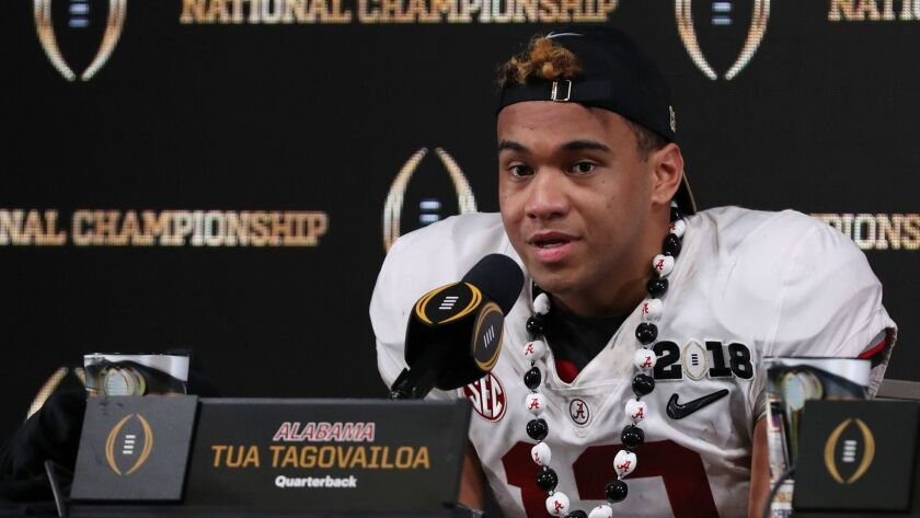 Alabama Crimson Tide quarterback Tua Tagovailoa (13) at a press conference after the 2018 CFP national championship college football game against the Georgia Bulldogs at Mercedes-Benz Stadium.
