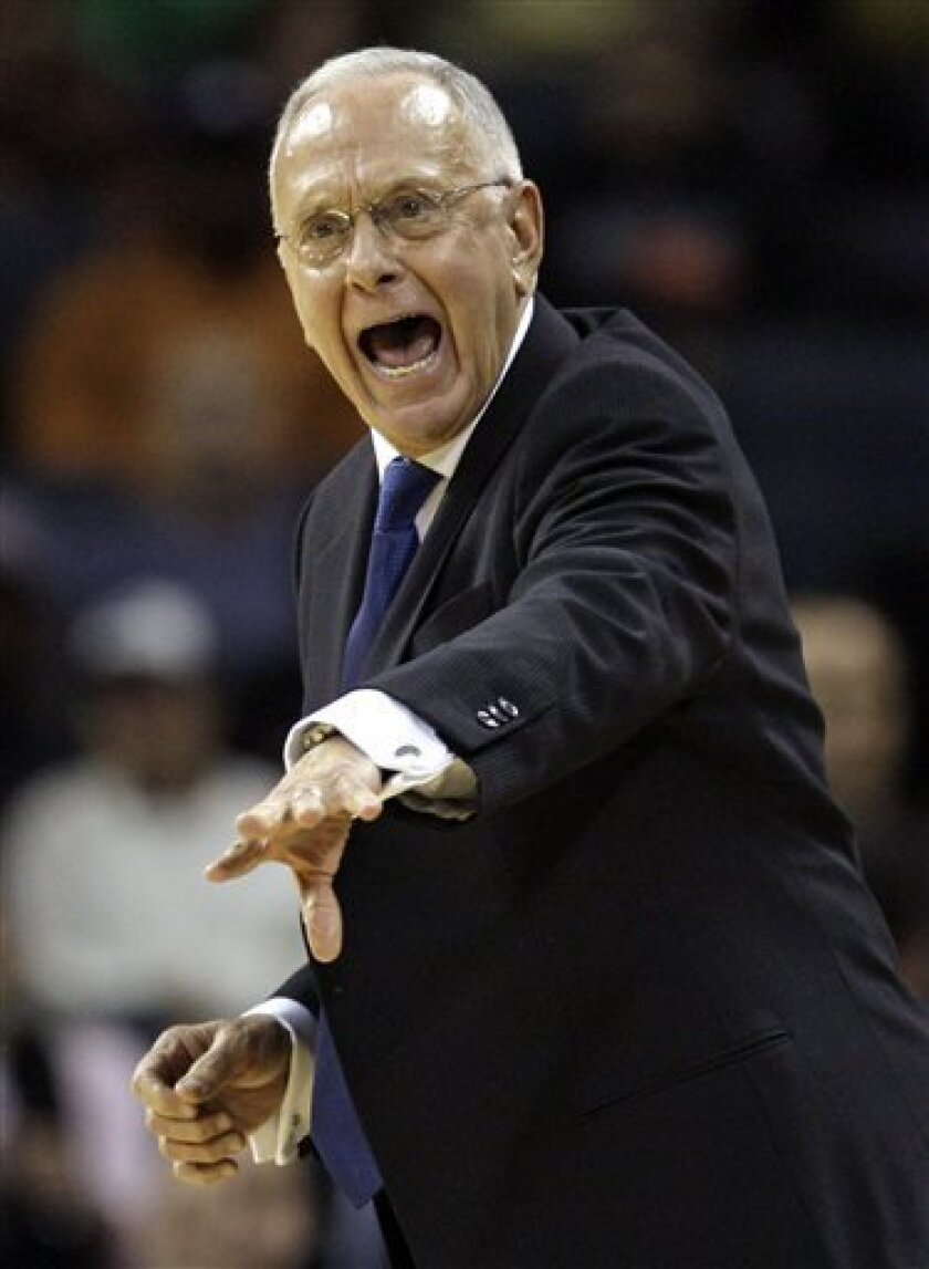 Charlotte Bobcats head coach Larry Brown directs his team against the Portland Trail Blazers during the first half of an NBA basketball game in Charlotte, N.C., Saturday, Jan. 17, 2009. (AP Photo/Chuck Burton)