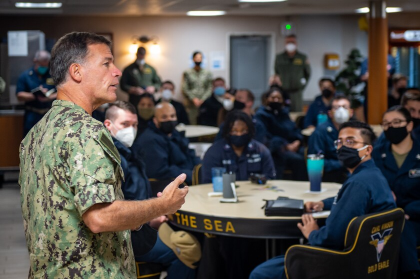 Adm. John Aquilino, commander of the U.S. Pacific Fleet, speaks with sailors on the aircraft carrier Carl Vinson