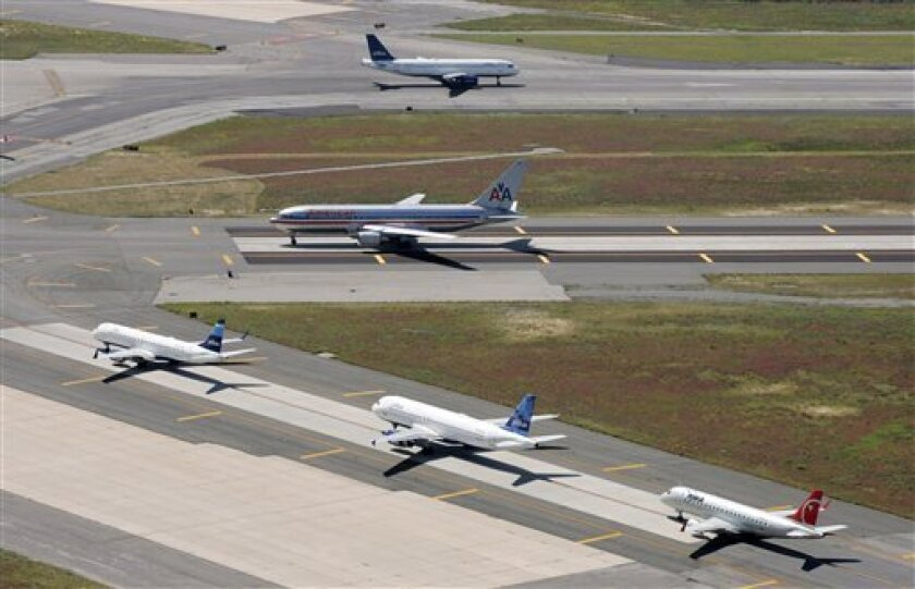 In this file photo of Sept. 8, 2008, planes taxi on runways at John F. Kennedy International Airport, Monday, Sept. 8, 2008 in New York. The jets are with American Airlines, JetBlue Airways, and Northwest Airlines. The main runway at New York's John F. Kennedy International will be closed for four months starting March 1, 2010. Millions of travelers will experience delays, including some not flying anywhere near the Big Apple. (AP Photo/Mark Lennihan, file)