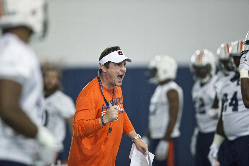 Auburn Defensive Coordinator Will Muschamp screams at a player during an indoor practice Aug. 4.