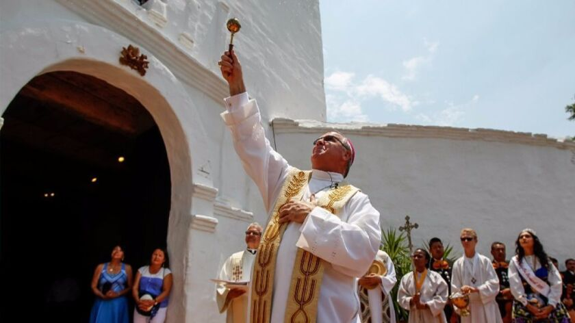 Auxiliary Bishop John Dolan blesses the bells during the Festival of the Bells at the Mission San Di
