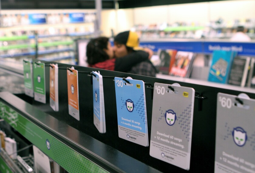 Napster gift cards on display. The investigation into a Calabasas accident, in which a former Napster executive was fatally hit by an Los Angeles County sheriff's patrol car while riding a bike, continues more than a month later.