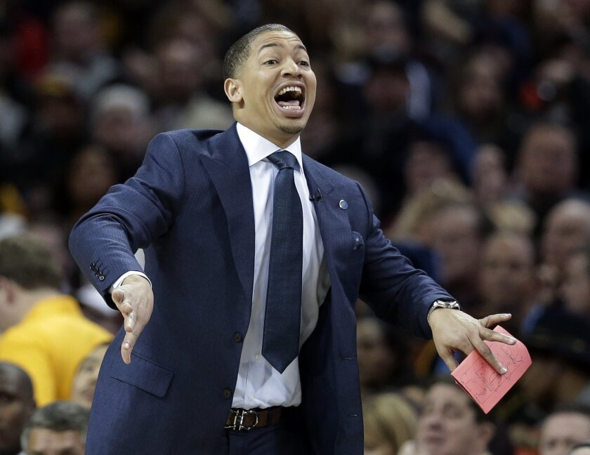 Cleveland Cavaliers head coach Tyronn Lue yells to players in the first half of an NBA basketball game against the Chicago Bulls, Saturday, Jan. 23, 2016, in Cleveland. (AP Photo/Tony Dejak)