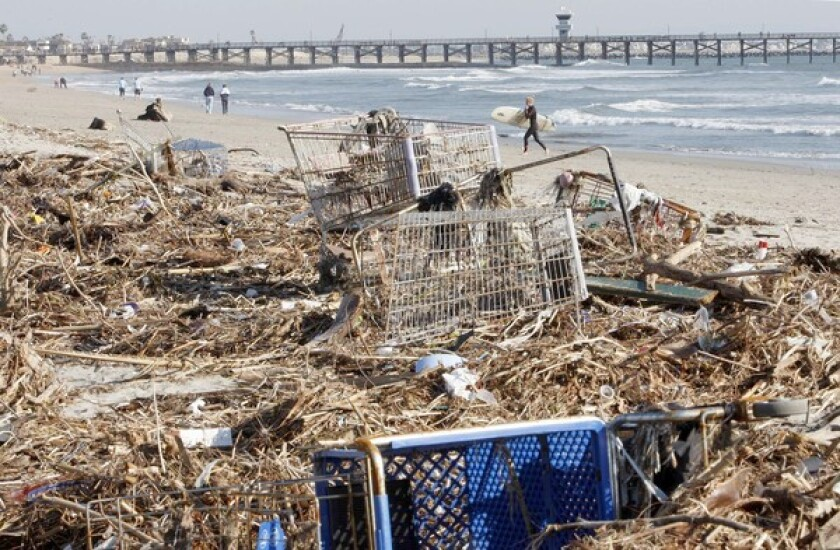 Heavy storms leave Southern California's shoreline littered with trash. The rainwater picks up trash from streets and dumps it onto beaches.
