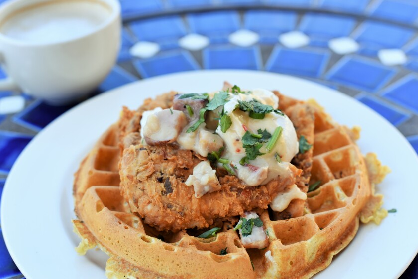Indulge your chicken and waffles craving with the Buttermilk Fried Chicken Waffle from Pacifica Breeze