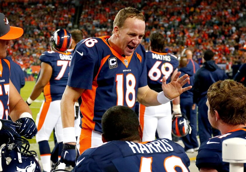 Denver Broncos quarterback Peyton Manning (18) talks to his teammates during the first half of an NFL football game against the Green Bay Packers, Sunday, Nov. 1, 2015, in Denver. (AP Photo/Jack Dempsey)
