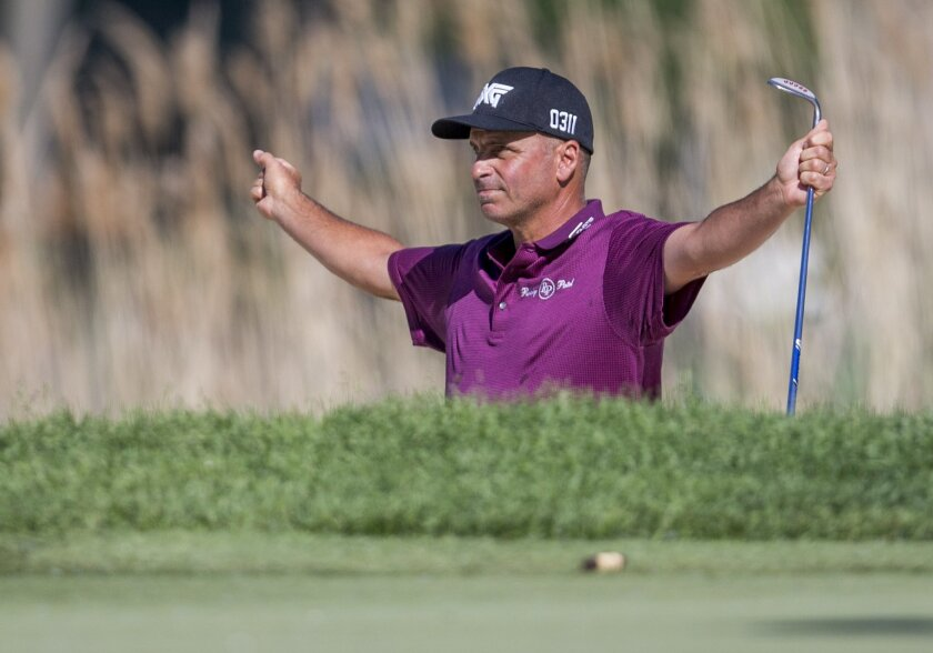 Rocco Mediate celebrates after sinking a shot from the second for a birdie on the 17th hole during the final round of the Senior PGA Championship golf tournament at Harbor Shores Golf Club in Benton Harbor, Mich., Sunday, May 29, 2016. Rocco Mediate won with a score of 19 under. (AP Photo/Robert Fr