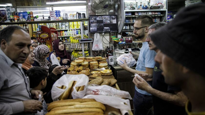JERUSALEM, ISRAEL -- THURSDAY, MAY 24, 2018: Bread is sold at the El-Amin bakery, as part of the Ram