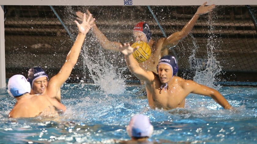 Newport Harbor goalie Blake Jackson makes a stop point blank during Surf League match at Corona del
