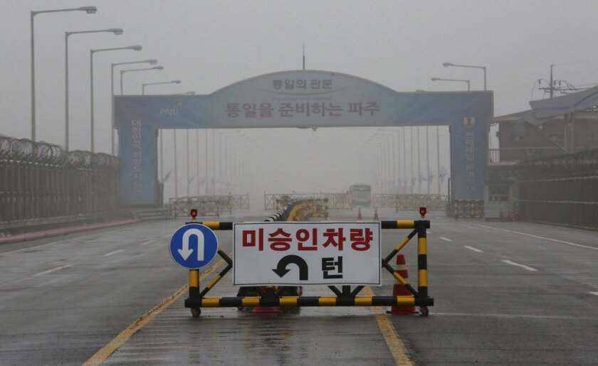 """A barricade is placed near Unification Bridge, which leads to the demilitarized zone, near the border village of Panmunjom in Paju, South Korea, Wednesday, May 16, 2018. North Korea on Wednesday canceled a high-level meeting with South Korea and threatened to scrap a historic summit next month between U.S. President Donald Trump and North Korean leader Kim Jong Un over military exercises between Seoul and Washington that Pyongyang has long claimed are invasion rehearsals. The barricade reads: """"Vehicles disapproved."""""""
