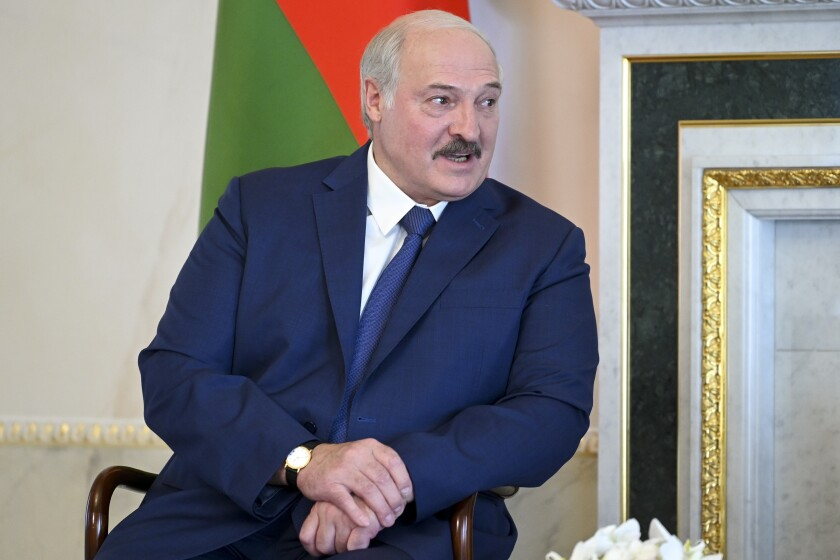 """Belarusian President Alexander Lukashenko listens to Russian President Vladimir Putin during their meeting in St. Petersburg, Russia, Tuesday, July 13, 2021. Putin has hosted the leader of Belarus, who has increasingly relied on Moscow's support amid increasing tensions with the West. Belarus' authoritarian President Alexander Lukashenko thanked Putin for a """"very serious support from Russia"""" and pledged that his country will duly repay its loans. (Alexei Nikolsky, Sputnik, Kremlin Pool Photo via AP)"""
