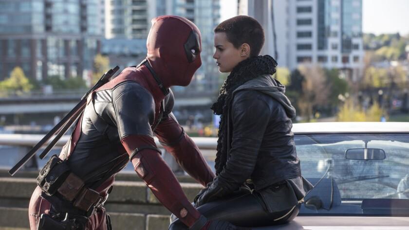 "Ryan Reynolds and Brianna Hildebrand in ""Deadpool."""