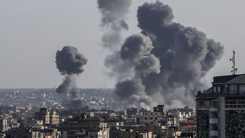 Smoke rises from buildings after Israeli air strikes in Gaza City on May 4. Palestinian militants launched rockets and mortars into southern Israel from Gaza; the Israeli military responded with airstrikes and tank fire against targets across the Palestinian coastal territory.