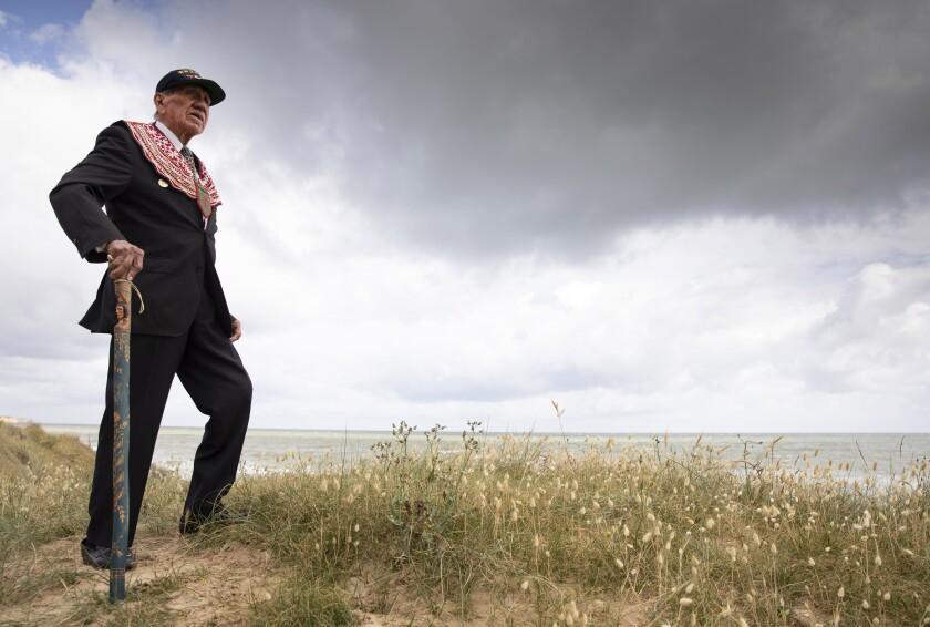 World War II D-day veteran Charles Shay on a dune overlooking Omaha Beach.