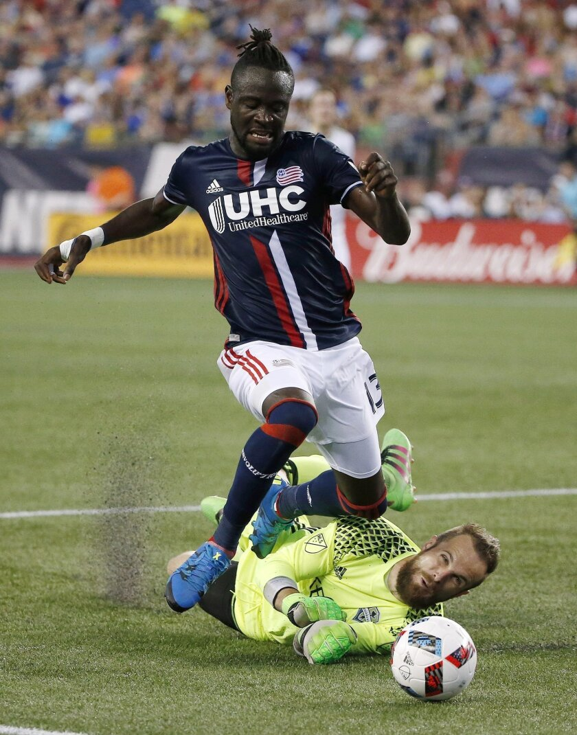 New England Revolution's Kei Kamara (13) and Seattle Sounders goalie Stefan Frei battle for the ball during the first half of an MLS soccer game, Saturday, May 28, 2016, in Foxborough, Mass. (AP Photo/Michael Dwyer)