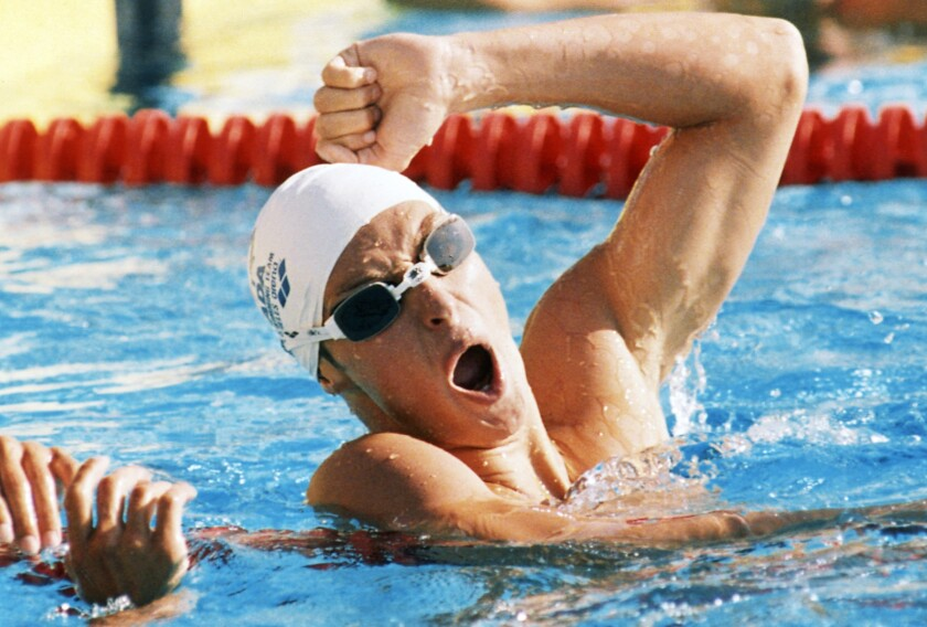 FILE - In this July 30, 1984, file photo Alex Baumann of Canada celebrates after winning the 400 Meter Individual Medley Swimming event, setting a new World Record time of 4:17.41 at the Summer Olympic Games in Los Angeles. Two-time Canadian Olympic gold medalist Baumann has been named chief executive of Swimming Australia, moving up from his current position as chief strategist at the sport's governing body Down Under. (AP Photo/Pete Leabo, File)