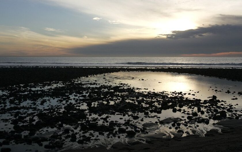 Camp Pendleton officials are investigating rocks from San Onofre State Beach that caught fire in a woman's pocket. They did not speculate about when their research would be done.